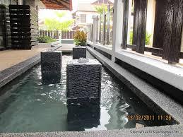 minimalist koi fish pond design in garden with fountain best design