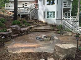 natural rock landscape design on a sloped and wooded backyard