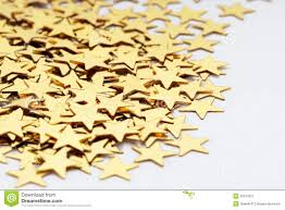 christmas decoration golden confetti stars against royalty free