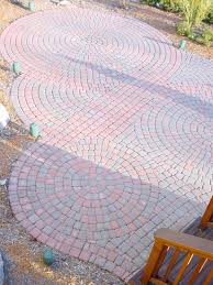 circular pattern red brick paver patio in northville design and