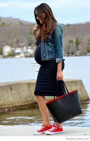 amazing and simple pregnancy with a black dress and a denim