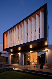 louvered shutters exterior modern with backyard cantilevered