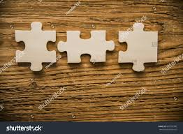 three 3 wooden pieces jigsaw puzzle stock photo 667593388