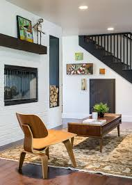 mid century remodel with see through wood burningn fireplace by