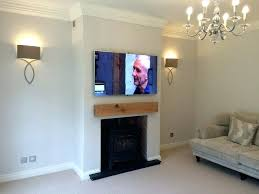 television over fireplace hanging tv over fireplace ideal mounting above fireplace install