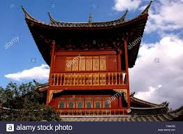lijiang china wooden tower house with upswept flying eave roofs
