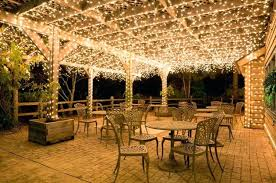 how to string lights across backyard pergola string lights icicle lights shimmer across pergola ceilings