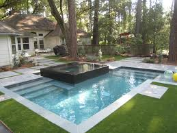 raised spa with negative edge spill over custom swimming pools