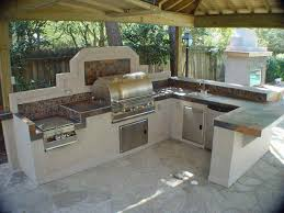 engaging u shape covered outdoor kitchen island featuring beige