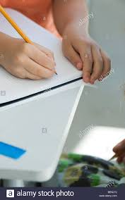 Writing On Graph Paper Student Writing On Graph Paper Cropped Stock Photo Royalty Free