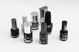 free stock photo of black and white nail polish