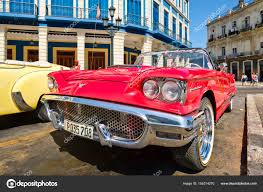 ford old vintage red ford thunderbird convertible car parked in old havana