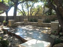 flagstone patio with columns with a dry creek bed running through
