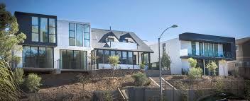Modern Two Storey House With Streamline Roof by Sofia Lofts Uli Case Studies