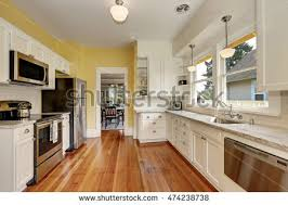Kitchen Yellow Walls - bright kitchen room green wall hardwood stock photo 177680402