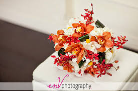 wedding flowers edmonton wedding bouquet inspiration orange white orchids by the