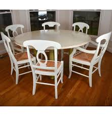 pottery barn round farmhouse style dining table with six chairs ebth