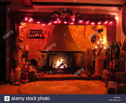 an inglenook fireplace in an english country cottage decorated at