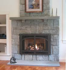 living room blaack fireplace insert with screen brick stone