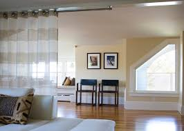 contemporary curtain rods family room beach with angled window