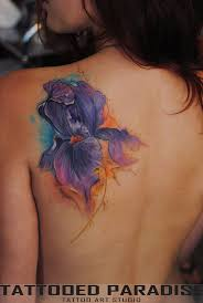 watercolor iris flower tattoo on left back shoulder