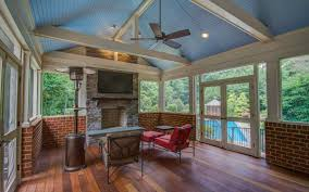 screened in porch with half brick walls vaulted blue ceilings