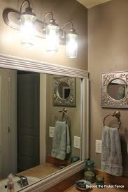 bathroom alder sunbrust glass lights above mirror contemporary