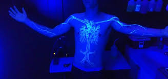 how much are black lights black light tattoos very beautiful black light tree on the chest