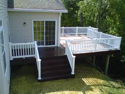trex transcends lava rock deck by archadeck with white wood rail