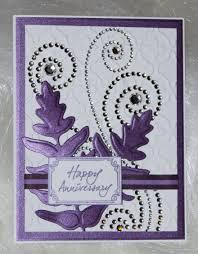 embossed anniversary card with rhinestone swirls