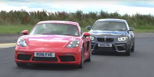 porsche cars 2016 watch the porsche 718 cayman s and bmw m2 battle on track
