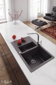 modern kitchen fixtures chrome faucets and quartz sinks from new teka collection in a mid