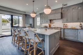 popular kitchen cabinets pair gray cabinets with warm colors and