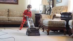 Vaccuming Little Boy Vacuuming Carpet In House Stock Video Footage Videoblocks