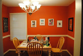 dining room orange wall design with chandelier ideas with brown