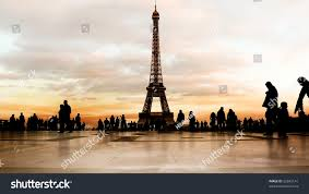 Beautiful Eiffel Tower by Beautiful Soft Colored Sky At Dusk Behind The Eiffel Tower In
