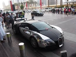 gold and white bugatti spotting cars in dubai