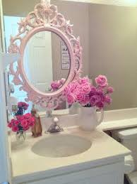 girly bathroom ideas looks like a frame has been attached to the large wall mirror