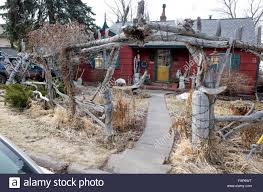 fanciful house with driftwood fence and entry trellis located in