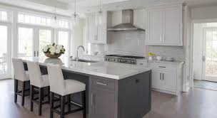 white kitchen cabinets grey island so many doors and windows awesome light side entrance idea