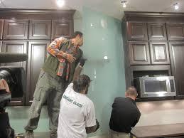 how install solid glass backsplash tos diy step