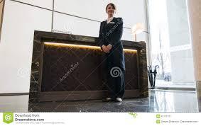 Standing Reception Desk by Female Concierge Standing Near Reception Desk Stock Video Video