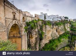 white houses hanging from cliffs in ronda spain view include