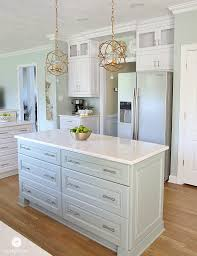 kitchen island base cabinets coastal kitchen makeover the reveal oysters cambria quartz
