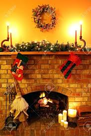 open log fire candles garland broomstick stockings stock photo