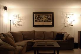 neutral living room using sectional sofa and torchiere floor lamps