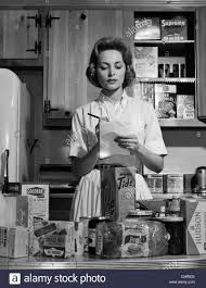 1960s woman housewife in kitchen checking grocery food shopping