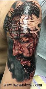 jesus on the cross motive tattooed tattoos