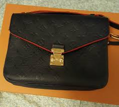 the new pochette metis empreinte leather which color page 16