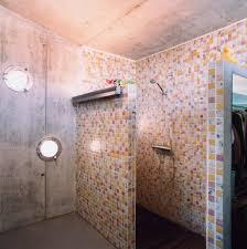 colorful vintage bathroom designs with frameless shower mosaic tiles